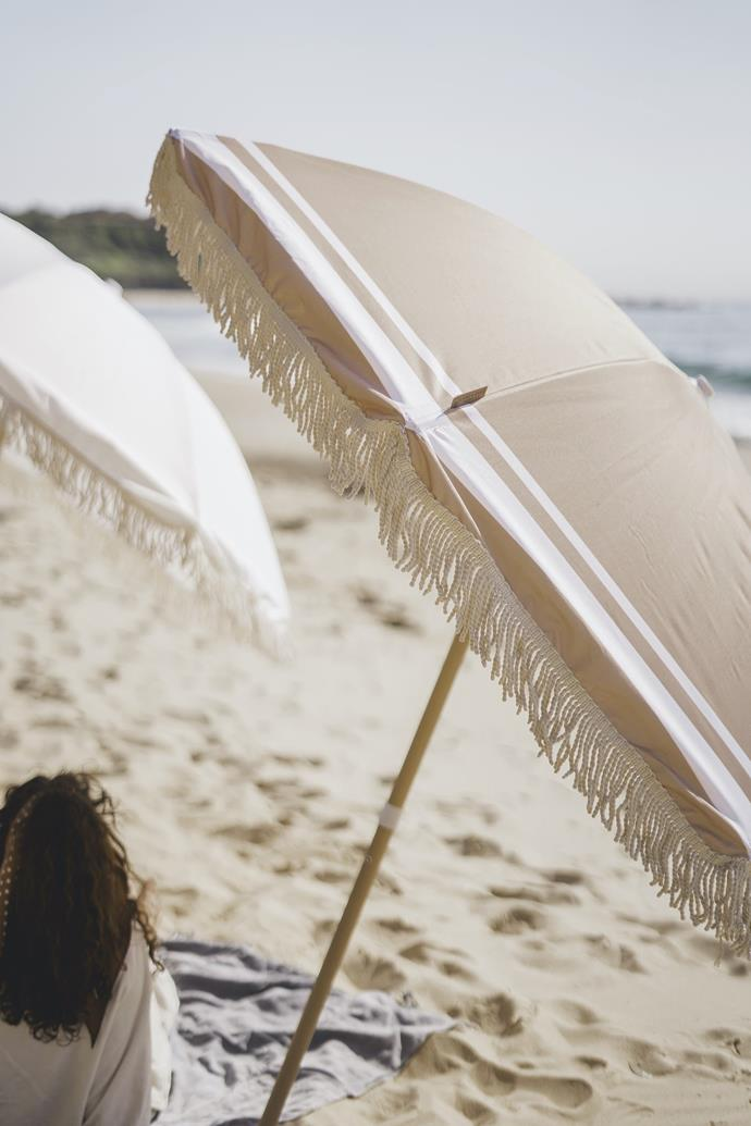 """**The Sustainable Beach Umbrella**<br><br>  With a fabric canopy crafted from recycled bottles (that offers UPF 50+, no less), this lightweight umbrella comes with a matching carry bag, boasts hidden pockets and offers almost two metres of shade.<br><br>  *'Franklin' Recycled Beach Umbrella by Land & Sand Essentials, $249 at [Land & Sand Essentials](https://fave.co/3gpCj0X
