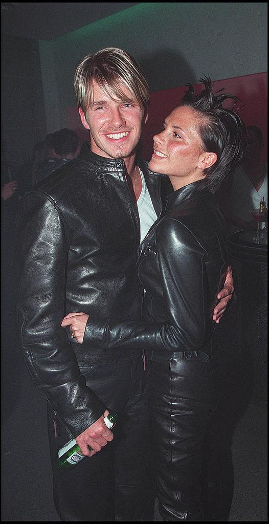 David and Victoria Beckham attending a Versace party in 1999.