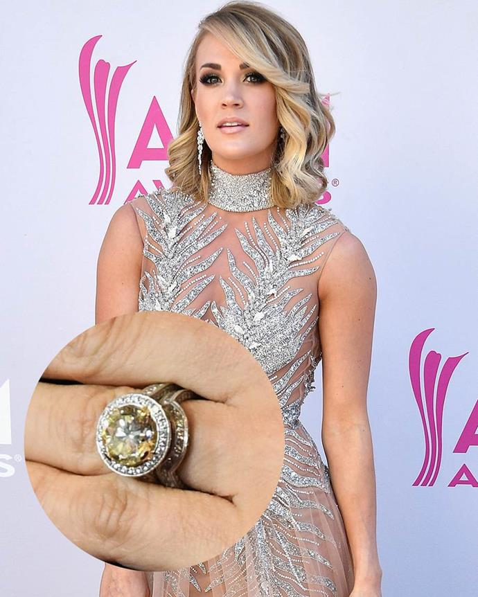 **Carrie Underwood**<br><br>  The five or six-carat canary diamond in Carrie Underwood's ring is surrounded by a diamond halo.