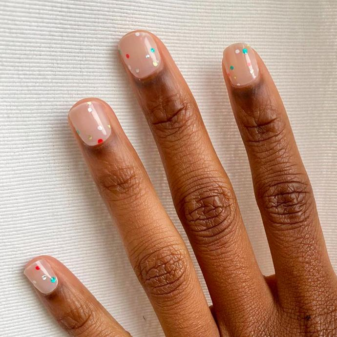 """**The Confetti Manicure** <br><br> If you prefer a party season that's all-year round, then look no further than the Confetti Manicure. The perfect isolation pick-me-up, this easy-to-achieve design is here to give your nails the love and attention they deserve. With a thin nail brush, or the back of a thin makeup brush, dot a selection of your favourite colours onto your nail—bonus points if you include a sparkler. <br><br> *Image via [@mpnails](https://www.instagram.com/p/B_nY1DmJ0Ao/