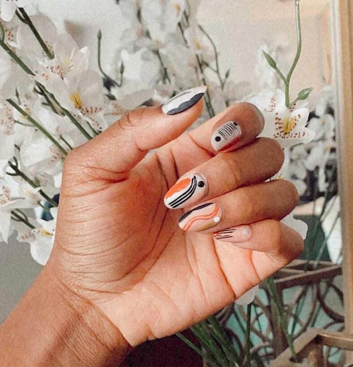 """**The Geometric Manicure** <br><br> On the hunt for a new kind of [abstract nail](https://www.elle.com.au/beauty/abstract-nail-art-23060