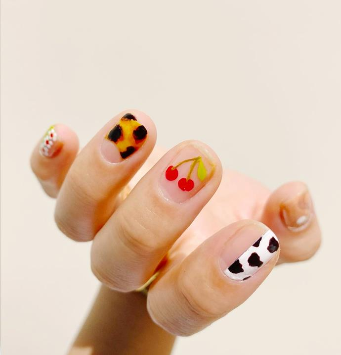 """**The Multi-Print Mani** <br><br> Pattern-on-pattern isn't just having a fashion moment. Taking the nail art world by storm, each nail should feature a different design—from singular motifs to intricate patterns—but in the *same* colour family. Whether you know an artist, you are one or you prefer the convenience on nail stickers, the Multi-Print manicure is perfect for the confusing year head. <br><br> *Image via [@thehangedit](https://www.instagram.com/p/CF7nYudn0PO/