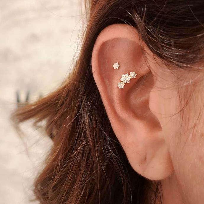 """**Which piercing styles/placements do you think will be everywhere in 2021?**<br><br>  The flat piercing (also known as a 'tash rook' piercing).<br><br>  *Image via [@mariatash](https://www.instagram.com/p/CEhq4IEHbuc/