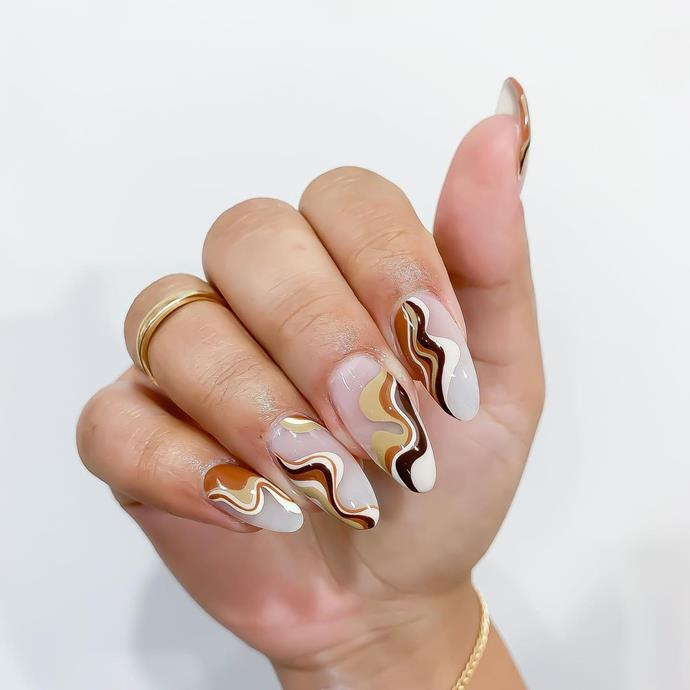 "A soft serve of swirls. Caramel, vanilla and espresso? All present.<br><br>  *Image: [@nails_and_soul](https://www.instagram.com/p/CJt29hwDvSb/|target=""_blank"")*"