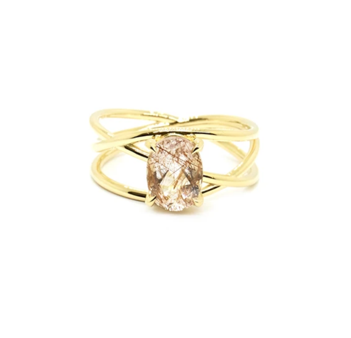 "Petite crossover ring in 14ct white gold with rutilated quartz, $2,550 by [Natalie Marie](https://www.nataliemariejewellery.com/collections/engagement-rings/products/petite-crossover-ring-rutilated-quartz|target=""_blank""