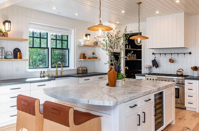 """The kitchen features a farmhouse sink and marble island as well as a built-in wine cooler. <br><br> *Image by [Realtor.com](https://nypost.com/2021/01/27/dakota-johnson-and-chris-martin-move-into-12-5m-malibu-home/?utm_medium=browser_notifications&utm_source=pushly&utm_campaign=792019