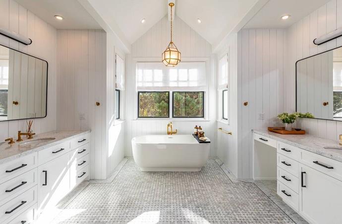 """The light-filled master bathroom featuring separate sinks and vanities and a stunning bath. <br><br> *Image by [Realtor.com](https://nypost.com/2021/01/27/dakota-johnson-and-chris-martin-move-into-12-5m-malibu-home/?utm_medium=browser_notifications&utm_source=pushly&utm_campaign=792019