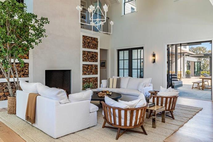 """Their living room boasts high ceilings, built-in shelves for endless wood supply, as well as double doors to the outdoor patio. <br><br> *Image by [Realtor.com](https://nypost.com/2021/01/27/dakota-johnson-and-chris-martin-move-into-12-5m-malibu-home/?utm_medium=browser_notifications&utm_source=pushly&utm_campaign=792019