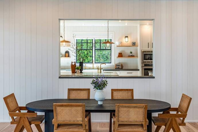 """The chic dining room features a full set of rattan chairs and a window to peek into the kitchen. <br><br> *Image by [Realtor.com](https://nypost.com/2021/01/27/dakota-johnson-and-chris-martin-move-into-12-5m-malibu-home/?utm_medium=browser_notifications&utm_source=pushly&utm_campaign=792019