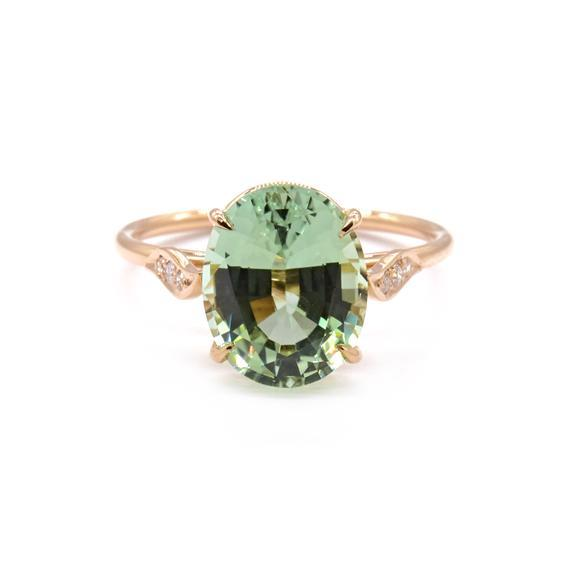 """'June' soliatire with mint green tourmaline and peta-shaped diamond shoulders, $8,110 by [Natalie Marie Jewellery](https://www.nataliemariejewellery.com/products/june-solitaire?_pos=6&_sid=baa7b822e&_ss=r