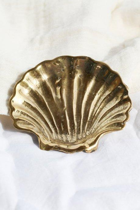 "Brass shell soap dish, $49.95 at [Frankie + Coco](https://frankieandcoco.com/products/brass-shell-dish|target=""_blank""