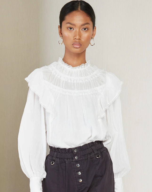"Giselle Top, $329 at [Magali Pascal](https://au.magalipascal.com/products/giselle-top-off-white?_pos=1&_sid=015a25526&_ss=r&variant=33315906617421|target=""_blank""
