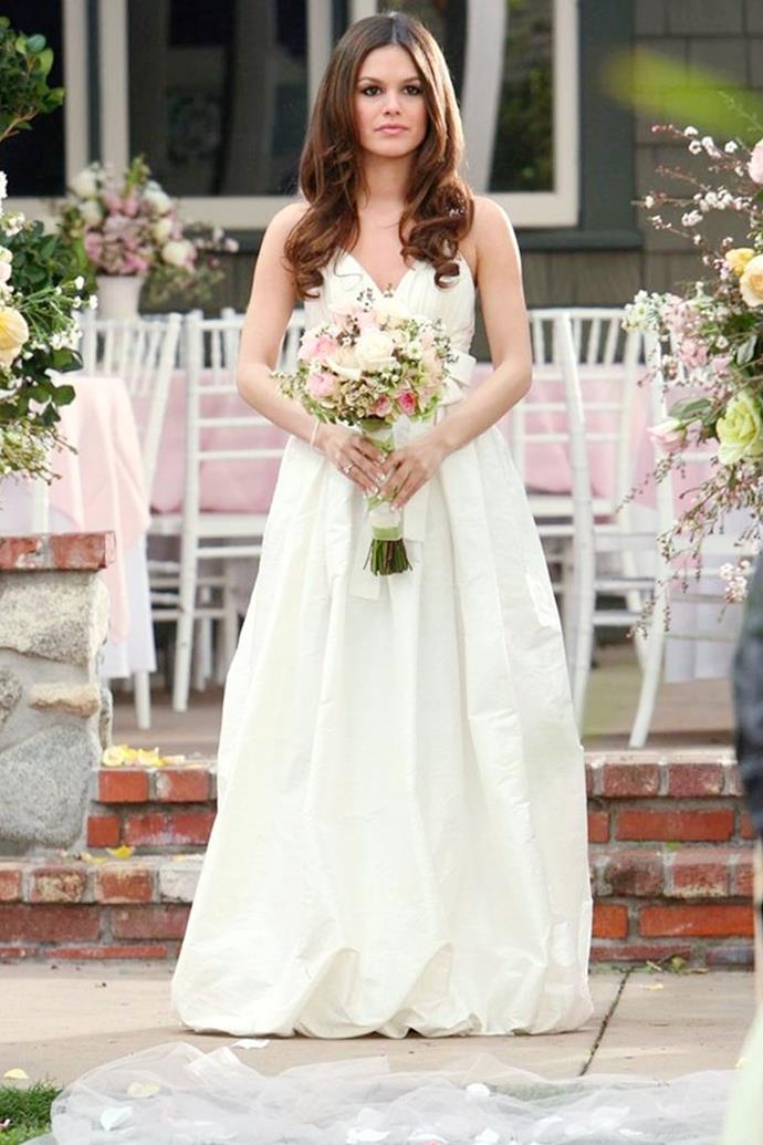 **The Series Finale Wedding Dress** <br><br> Every fan of *The O.C.* remembers Seth and Summer's tear-jerking wedding in the series finale, but only true fans remember her choice in wedding gown that surely inspired brides for years to come. A classic style, she opted for a subtle-yet-full skirt and a timeless, thin-strapped bodice.
