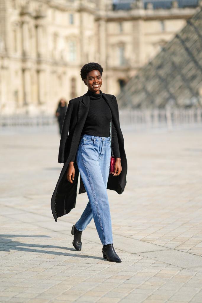 Parisian classics: blue jeans and sleek coat.