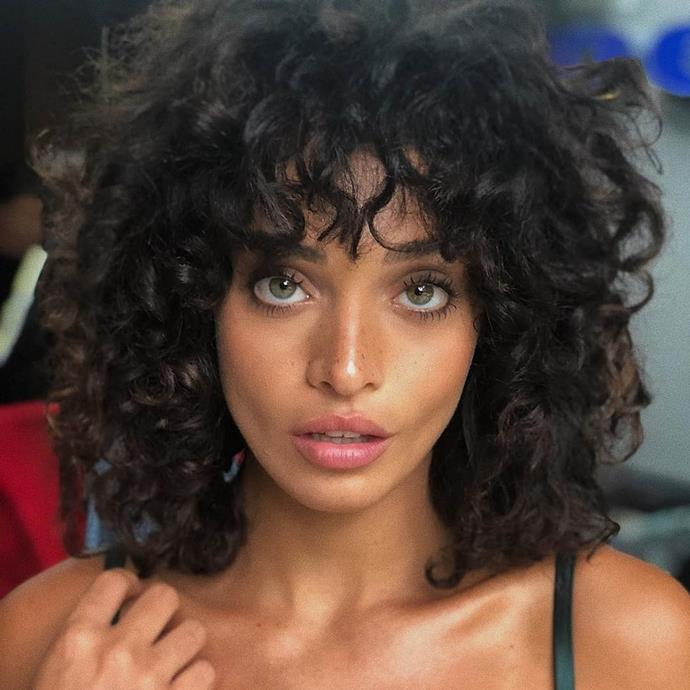 """**THE SHAG**<br><br>  The shag might be a '70s classic, but it's anything but outdated. In 2021, the take is sexier, curlier, and softer, with rough tendrils forming effortless fringes and lived-in layers creating a sensual halo. Okay, okay, it's not *exactly* effortless, but your hairdresser will know how to shape the internal layers so your locks can get the look without much of the work.<br><br>  *Image: [@edenfines](https://www.instagram.com/edenfines/