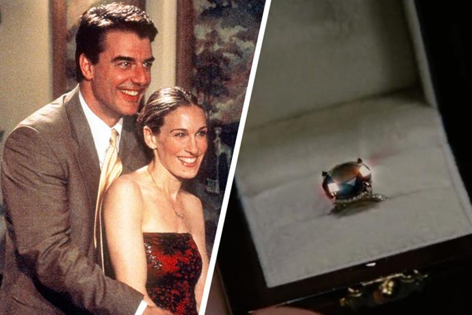 """**Carrie Bradshaw & John James Preston, Mr. Big** <br><br> When Big presents Carrie with a black diamond as the finale of the iconic series, we knew it had to be good. After a kiss with Aidan in Abu Dhabi, Mr. Big gives Carrie a 5-carat black diamond engagement ring, and like the audience, she asks, """"why black?"""" to which he responds """"because you are not like anyone else.""""  <br><br> Interestingly, jewellery designer Itay Malkin worked in collaboration with Sarah Jessica Parker and Patricia Field to create the piece—which is still just as iconic today. And yes, this time, Carrie decides to wear it on *that* finger."""