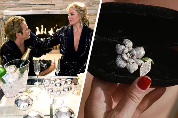 """**Samantha Jones & Smith Jerrod** <br><br> While not technically an *engagement ring*, the stunning piece of jewellery is just too perfect for the outspoken Samantha, who describes the piece just like her: """"one of a kind, filled with fire."""" She may have wanted to purchase the $50,000 piece for herself, designed by by Romona. M Boucher of Bastion, but Smith beats her to it. Eventually, the pair break up and the piece becomes a momento for the wonderful years they shared."""
