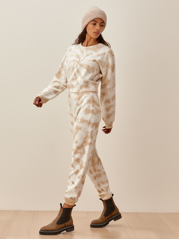 """From sustainable-cool-gal brand Reformation comes this organic cotton tie dye sweats set. The muted clay colour is particularly soothing.<br><br>  *Reformation Hunter Sweatshirt, $89.17 from [Shopbop](https://go.skimresources.com?id=105419X1569491&xs=1&url=https%3A%2F%2Fwww.shopbop.com%2Fhunter-sweatshirt-reformation%2Fvp%2Fv%3D1%2F1510594293.htm target=""""_blank"""" rel=""""nofollow""""). Reformation Classic Sweatpants, $102.28 from [Shopbop](https://go.skimresources.com?id=105419X1569491&xs=1&url=https%3A%2F%2Fwww.shopbop.com%2Fclassic-sweatpant-reformation%2Fvp%2Fv%3D1%2F1522205945.htm target=""""_blank"""" rel=""""nofollow"""").*"""