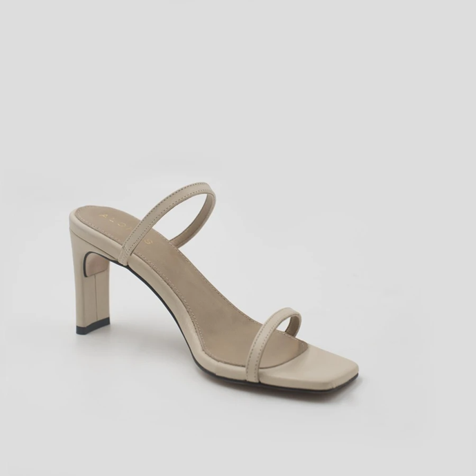 "If you're going to risk a shoe as a Mother's Day gift, make it one that goes with everything: the '90s strappy sandal. The footwear equivalent of the slip dress, the unembellished style lends a chic polish to denim pieces, tailored separates and flowing skirts. We're into this option from sustainability-concious brand Alohas. <br><br> *Cannes Sandal, $173 currently on sale for $147 from [Alohas](https://www.alohas.io/collections/sandals/products/cannes-beige?variant=31566481129550|target=""_blank""