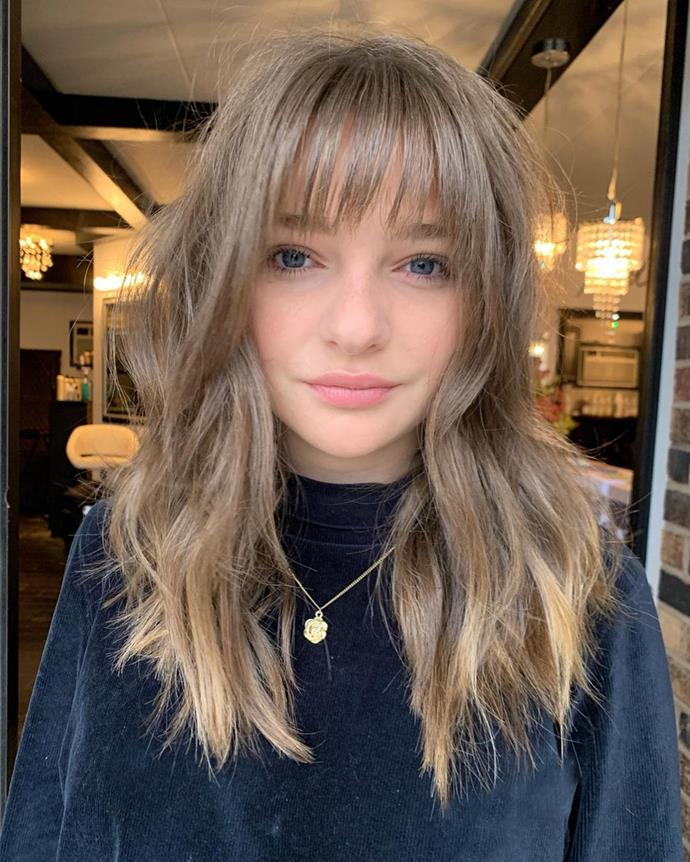 **The Subtle Long Shag Haircut**<br><br>  With long layers and a straight fringe erring on the wispier side, a shag haircut with layers that predominantly begin in the mid-lengths of the hair is the perfect way to ease yourself in. This style is ideal if you're still looking to preserve length, but want to add a bit more shape and personality to your hair.<br><br>  *Image via Instagram @nicolemariesalon.*