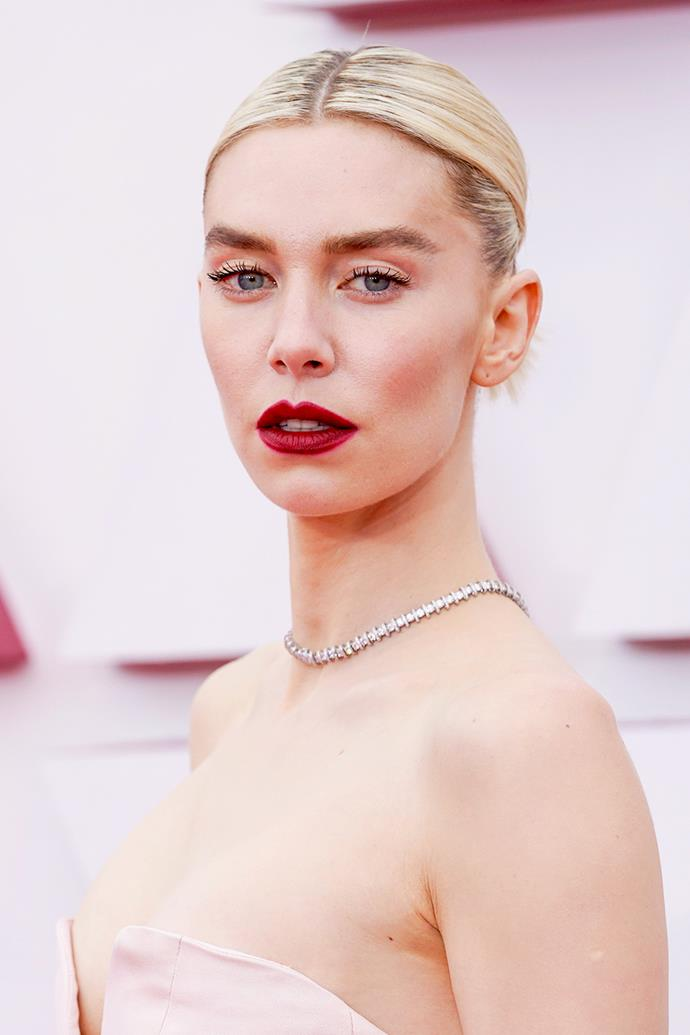 Vanessa Kirby opted for old Hollywood glamour with brushed up brows, fluttering lashes and a daring, cherry red lip.