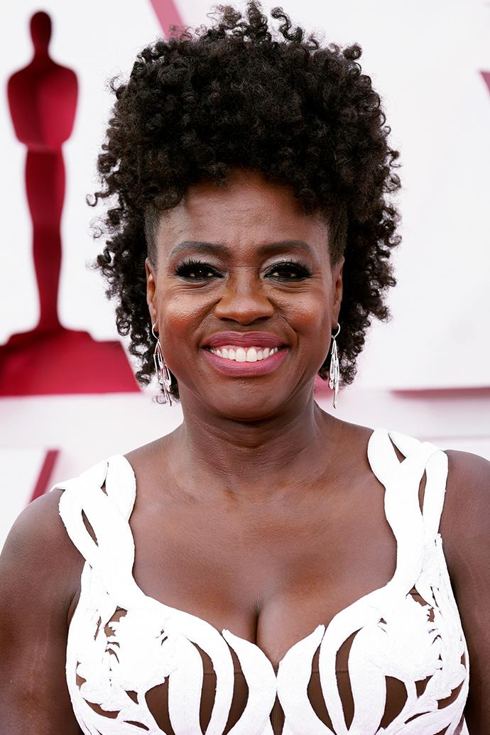 Viola Davis was nearly unrecognisable with a tall updo, bold lashes and a neutral lip.