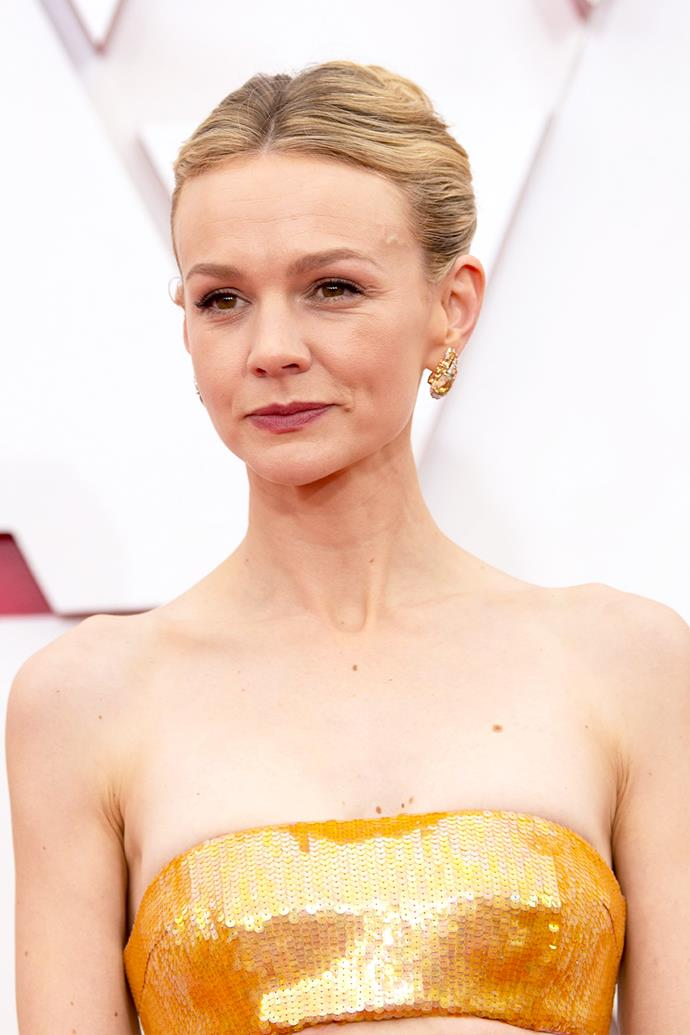 Carey Mulligan opted for a chic updo, warm-toned eye and a dusky rose lip.