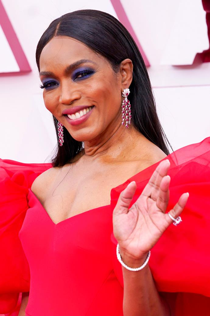 Angela Bassett opted for slicked, straight locks with a centre part, as well as an indigo eye and a crimson lip.