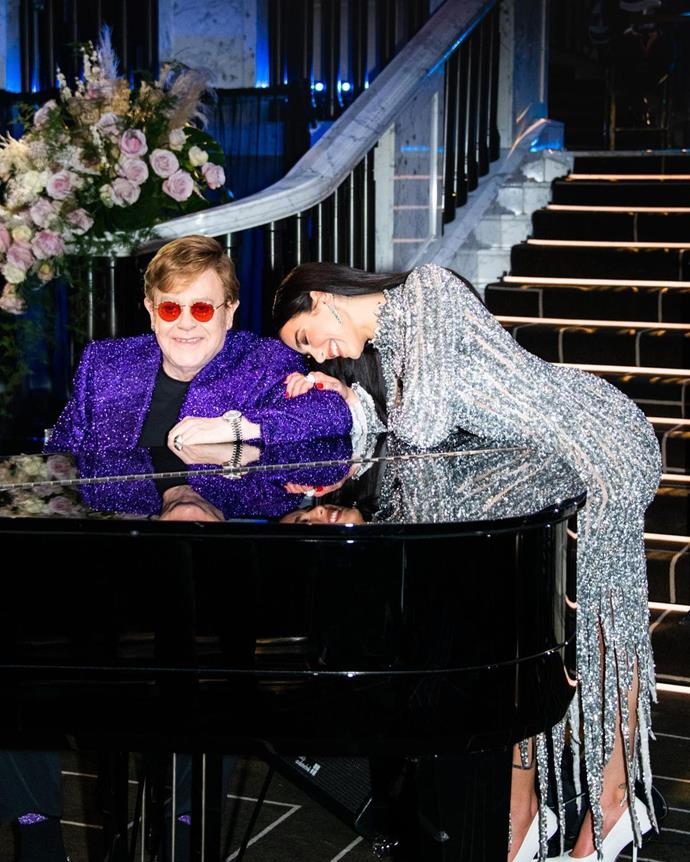 Elton John donned a violet embellished suit with his signature rose-tined glasses.
