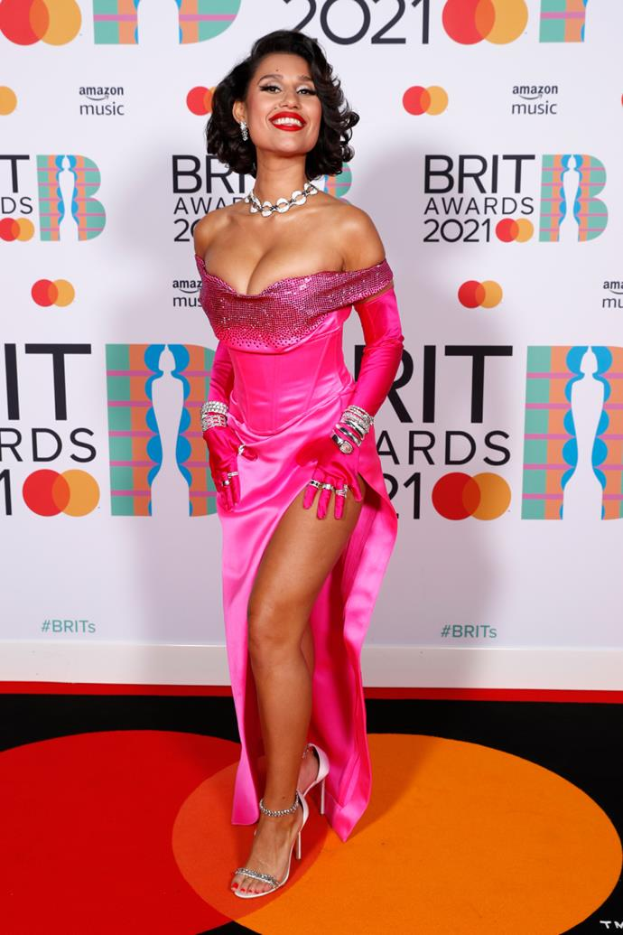 Raye in a neon pink Marilyn Monroe-inspired gown by Etro.