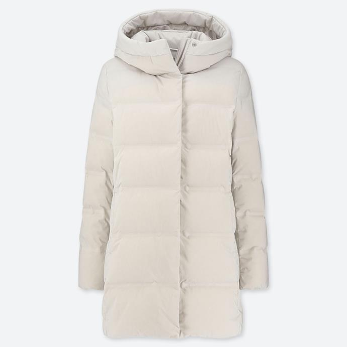 """WOMEN Seamless Down Short Coat in Natural, $149.50 at [Uniqlo](https://fave.co/3kVPHhM target=""""_blank"""" rel=""""nofollow"""")."""