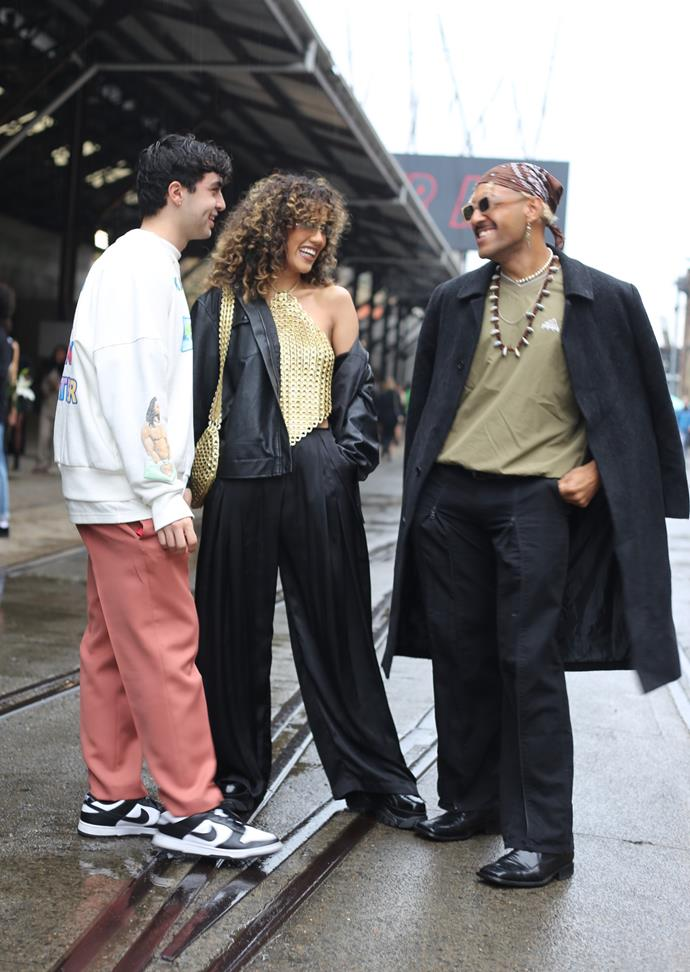 Becca wears a top and bag from DeLater, pants from Denise M Vera and shoes from Windsor Smith. Kian wears a jumper from Yeezy and suit pants from Acne Studio.