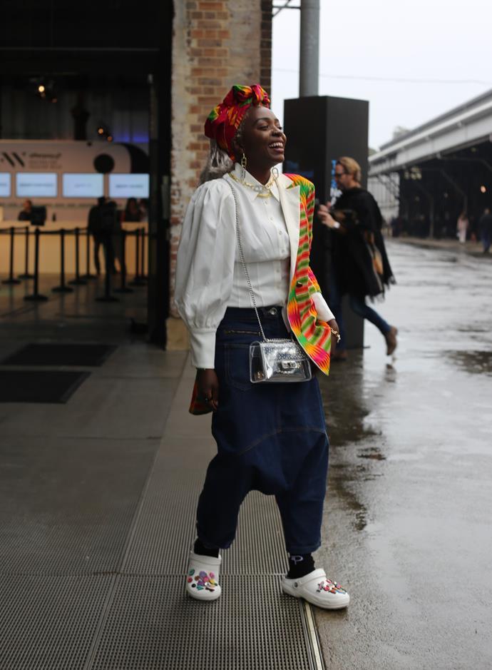 "[Suzan Mutesi](https://www.instagram.com/suzan_mutesi/?hl=en|target=""_blank""|rel=""nofollow"") wears Crocs, Steve Madden bag, African print jacket from Ghana and Emma Pills jewellery."