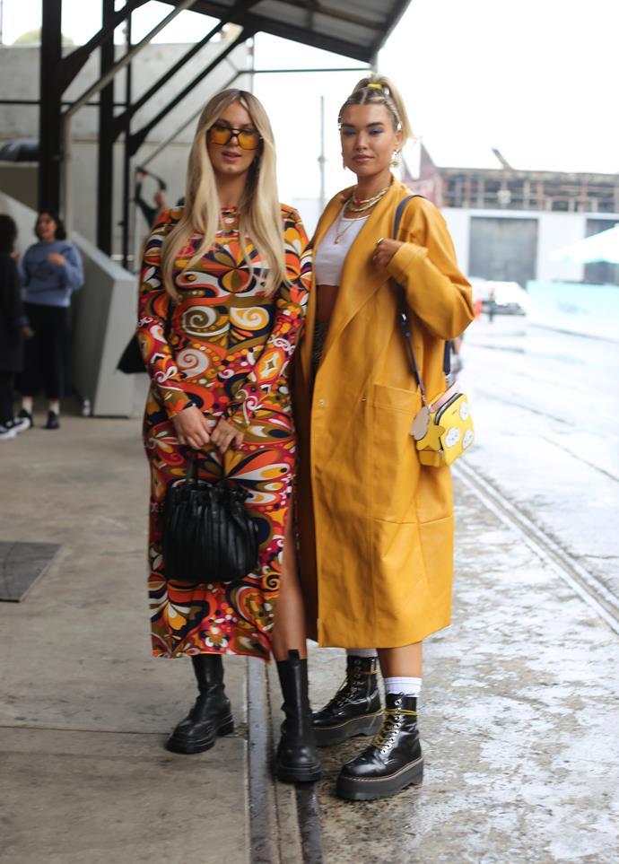 "[Tega Phillipa](https://www.instagram.com/teganphillipa/?hl=en|target=""_blank""|rel=""nofollow"") wearing a yellow Nasty Gal jacket, Attic skirt, Bonds singlet, Doc Marten boots and a GUESS bag. [Jem Jade Hahn](https://www.instagram.com/jemjadehahn/?hl=en|target=""_blank""|rel=""nofollow"") wears a colourful patterned Zara dress, Alias Mae shoes, Wildthegang sunglasses and a  David Jones bag."