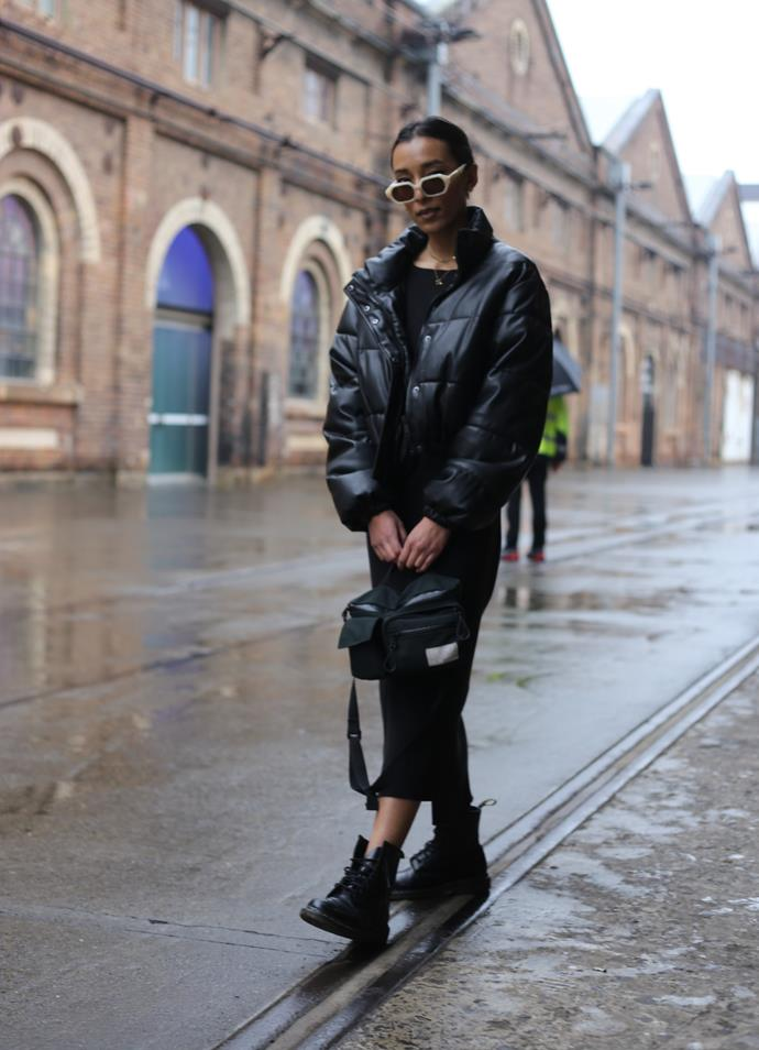 Monisha Rudhran wears sunglasses from Local Supply x Holiday the Label, dress from Bassike, boots from Doc Martens, bag from Nanamica and a jacket, borrowed from her sister.