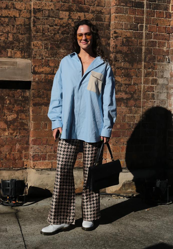 "[Ally May Carey](https://www.instagram.com/allymaycarey/|target=""_blank""|rel=""nofollow"") wears Blanca shirt, Venroy pants, Dr Martens x Comme de Garson shoes, St. Agni bag and Stella McCartney sunglasses. <br><br> Photography by: [Nikki Chowdhury](https://www.instagram.com/nikkidury/?hl=en|target=""_blank""|rel=""nofollow"")"