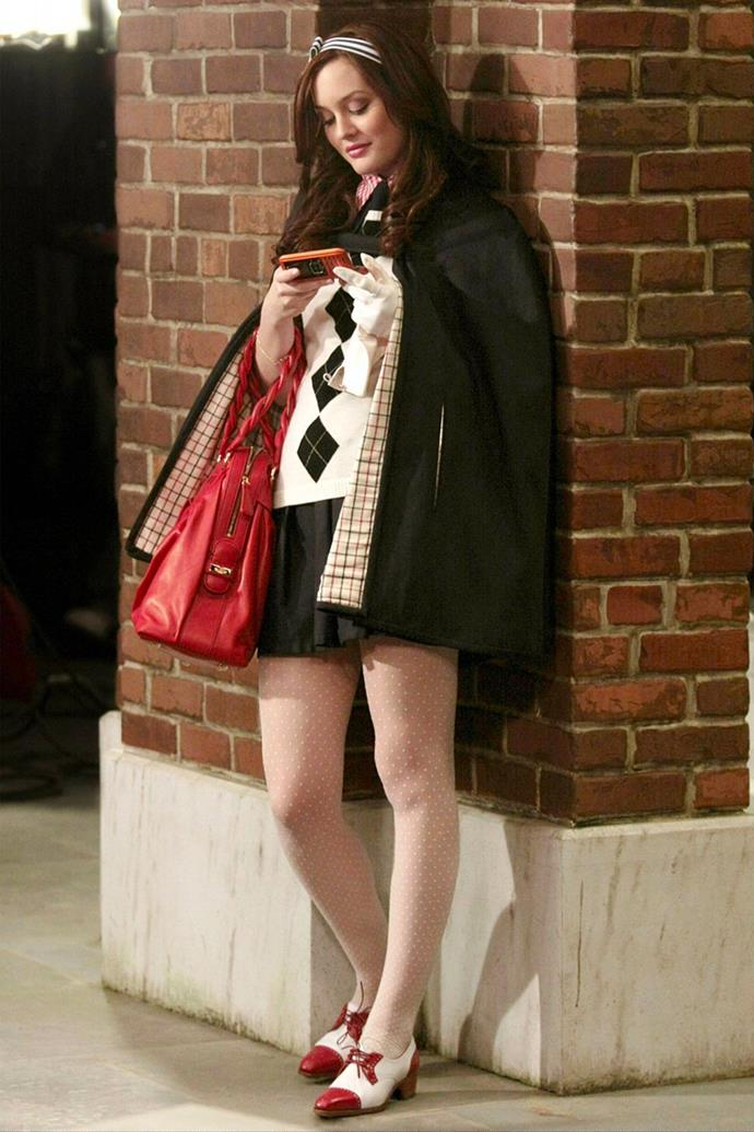 Yet another ode to Arygle knitwear, but this time with a cape jacket, crimson handbag, bowling-style footwear and a SideKick playing Flo Rida to successfully traumatise Nelly Yuki.