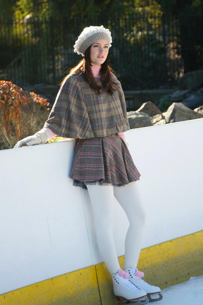 A matching tartan poncho and mini skirt, white tights and matching beret perfect for tripping over your father's partner, Roman.