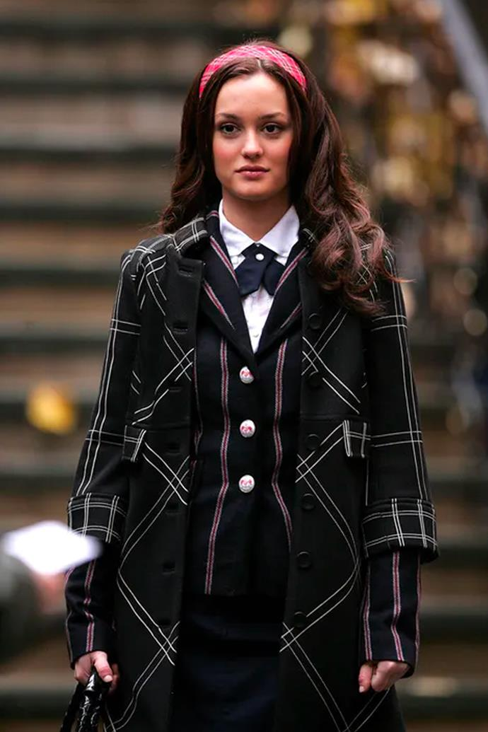 Adding to her collection of print-on-print moments with a tartan and striped school uniform and red tartan headband.