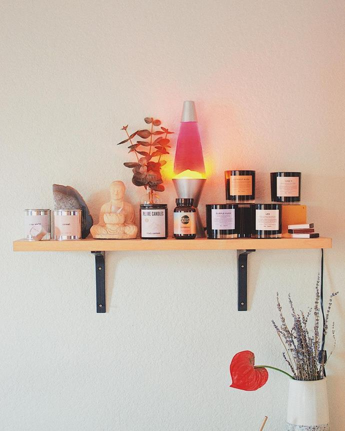 """**Group Your Candles**<br><br>  Whomst among us hasn't made an entirely unnecessary candle purchase at some point in our life? Whether they were thoughtful gifts or you're still recovering from a raging soy-wax addiction, candles both lit and unlit are a popular way to add some ambience to a room.<br><br>  A bedroom decor idea we picked up from Instagram creator Kristian Theo ([@kristiantheo](https://www.instagram.com/krstiantheo/ target=""""_blank"""" rel=""""nofollow"""")), was to give your candle collection the pedestal it deserves. Grouping them together with a few other select pieces—we enjoy the contrast of the lava lamp and the Buddha statue—makes it look more 'artful collection' than a sale table in a homewares store."""