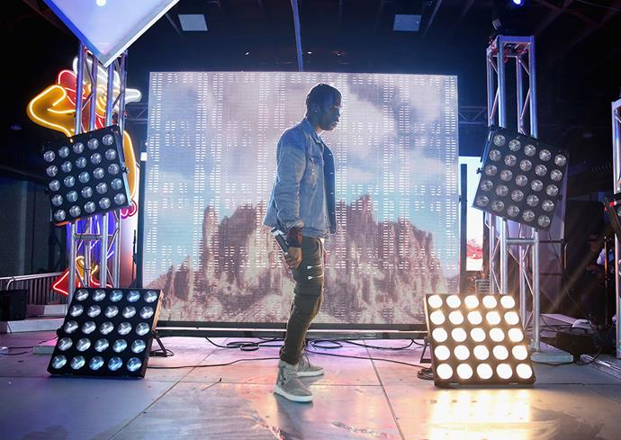 *Travi$ Scott performs at Tumblr IRL Presents Travi$ Scott At SXSW, with Art By Marc Kalman and Corey Damon Black on March 20, 2015 in Austin, Texas. Image via Robin Marchant/Getty Images for Tumblr.*