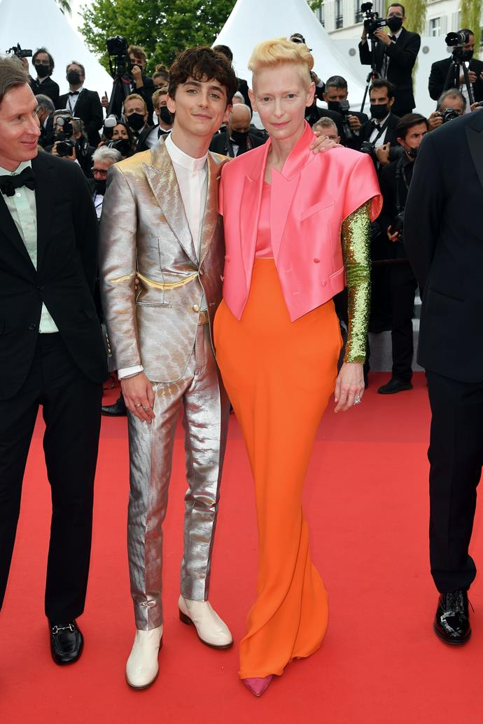 Timothée Chalamet in a two-piece metallic suit by Tom Ford and Tilda Swinton in Haider Ackermann.