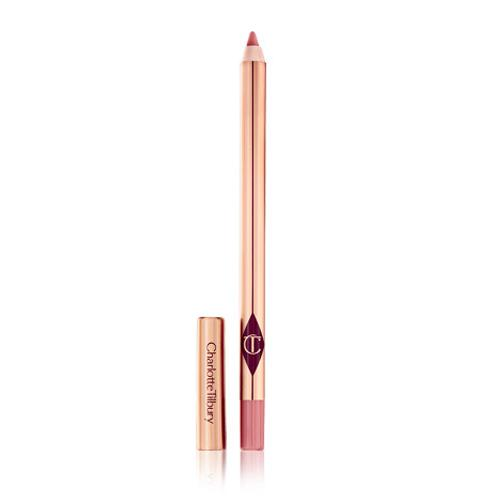 """**Charlotte Tilbury Lip Cheat in Pillow Talk** <br><br> **What they say:** *A nude pink lip liner; smoothes over texture for a seamless line, so you can resize and reshape for a fuller pout; lasts up to six hours with no smudging; waterproof formula.* <br><br> There's nothing worse than dragging a lip liner over your pout, just to be left with no colour transfer and a lot of pain. But Lip Cheat? Expect no such thing. Gliding effortlessly over the lip line, its creamy formula paints onto the skin vibrantly on the first try. Several passes are necessary to match the original Pillow Talk colour, but the liner is sure to last you hours—just like it promises. And with its super fine tip, lining lips from thin to full is quick, simple and hard to fault. <br><br> ***Shop [here](https://fave.co/3eqR7fX target=""""_blank"""" rel=""""nofollow"""").***"""