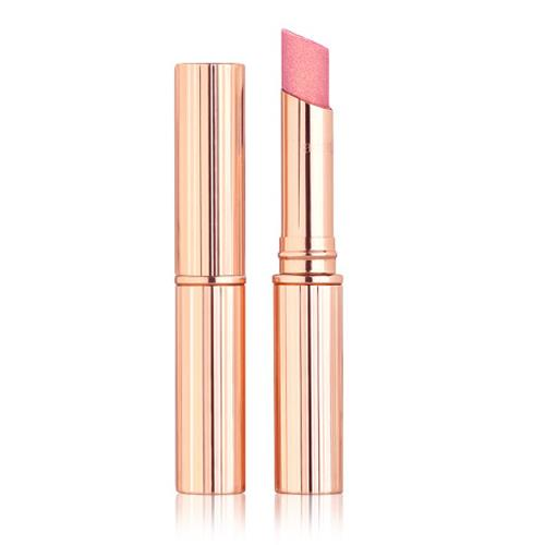 """**Charlotte Tilbury Pillow Talk Diamonds** <br><br> **What they say:** *A sheer rose-pink lipstick with a dreamy veil of golden sparkle; mineral-based glitter pigments capture and reflect the light for a multi-dimensional pout; sunflower seed oil and hops extract nourish and condition; microcrystalline wax adds stretch and bounce* <br><br> If you're a fan of sparkle, look no further than Pillow Talk Diamonds. With the consistency of a light, shimmer balm, it applies to the lips incredibly smoothly, however it's quite translucent, meaning reapplication is a must. With an almost rose-gold shine, the product doesn't show obvious flecks of glitter, but rather an overall (and incredibly flattering) glow. Perfect for layering, apply it over the original Matte Revolution on the peak of your pout for a radiant finish, or even dab onto the eyelids for a subtle shimmer. <br><br> ***Shop [here](https://fave.co/3Bc96jS target=""""_blank"""" rel=""""nofollow"""").***"""