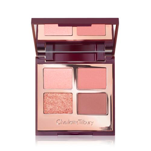 """**Charlotte Tilbury Pillow Talk Luxury Palette** <br><br> **What they say:** *An everyday  palette that gives a natural, effortless finish; Four colour-coded, universally-flattering shades enhance all eye colours and those aged 18-80; features 2 rich, matte shades and 2 satin, shimmer shades.* <br><br> There's no denying that from first glance, the Luxury Palette is a dream. Filled with gorgeous hues of pinks, neutrals and a warm, gold glitter, the colour range certainly screams romance. The two matte shades are gorgeous, however, require building if you're after a strong colour payoff. While the two satin, shimmer shades effortlessly shine after the first swipe. Each shade is smooth to apply, and over all, the quadrant is a perfect daily must-have or an easy and compact product to leave the house with. <br><br> ***Shop [here](https://fave.co/3z3CR4O target=""""_blank"""" rel=""""nofollow"""").***"""