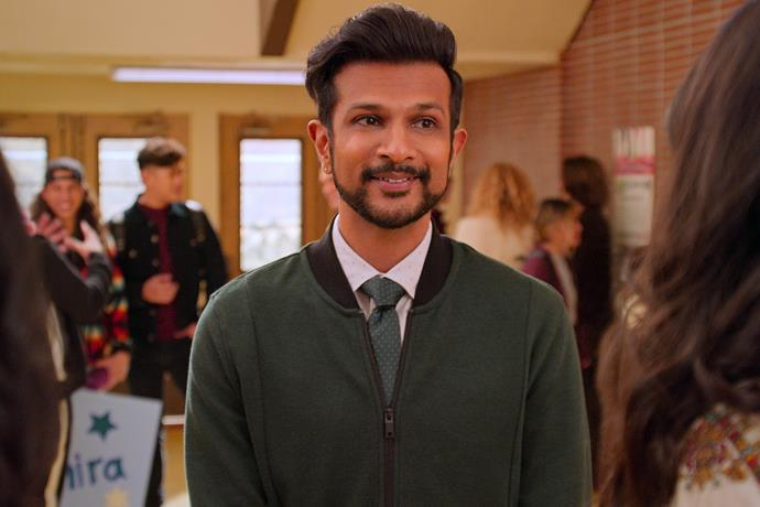 """**Utkarsh Ambudkar as Mr. Kulkarni** <br><br> Mr. Kulkarni is Devi's English (and favourite) teacher, who doubles as a football coach.  <br><br> Utkarsh is best known for his work on *The Mindy Project, Pitch Perfect, Key & Peele, Tom & Jerry, The Broken Hearts Gallery* and *Godmothered*. <br><br> *Check out season two of Never Have I Ever on Netflix **[here](https://www.netflix.com/title/80179190