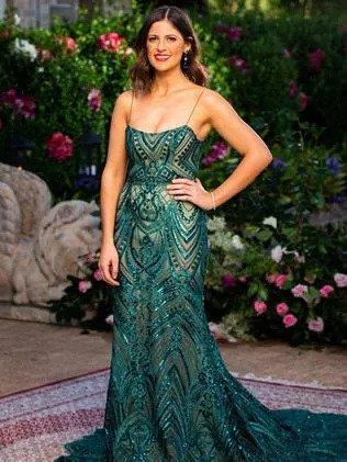 """Laura wears a dress from [By Kinsman](https://www.bkthelabel.com/ target=""""_blank"""" rel=""""nofollow"""")."""
