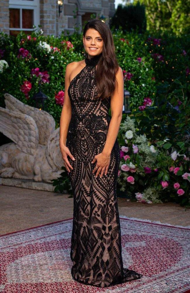 """Brooke wears a dress by [Breeanna Maree](https://www.breeannamaree.com/ target=""""_blank"""" rel=""""nofollow"""")."""