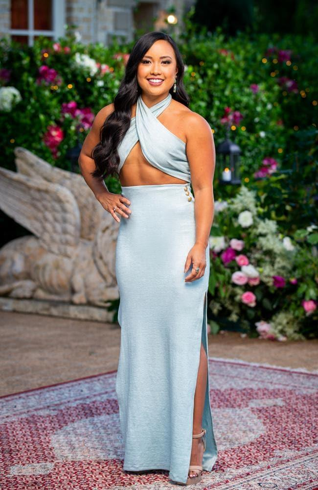 """Elena wears a two-piece set from [Amy Taylor Collection](https://amytaylorcollection.com/ target=""""_blank"""" rel=""""nofollow"""")."""
