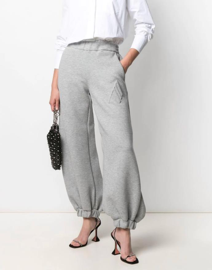 """Oversized cuffed track pants by The Attico, $672 at [Farfetch](https://fave.co/3f5BuuX target=""""_blank"""" rel=""""nofollow"""")."""